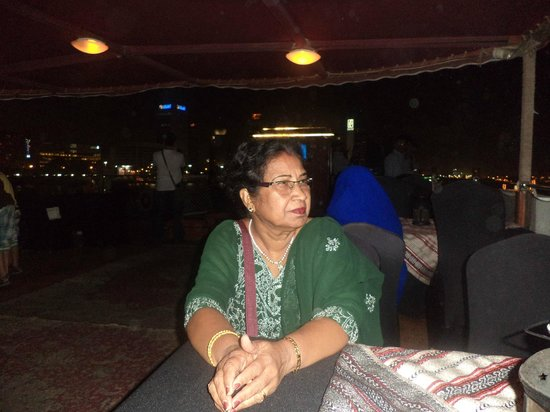 Dhow Dinner Cruise:                   Contributor's wife enjoying out side view from boat with bar at the back
