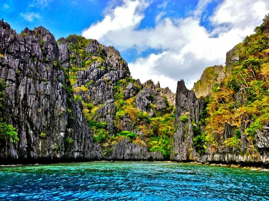 El Nido Resorts Miniloc Island :                                     Limestone Cliff beside Miniloc Resort