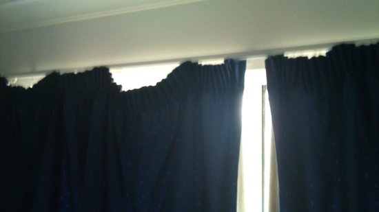 Sunshine Beach Resort:                   curtains hanging with stains