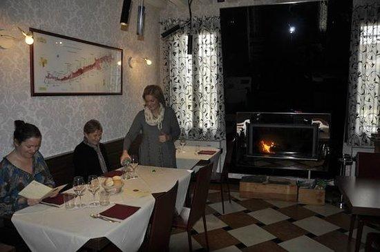 "Locanda Osteria Veneta ""da Piero"" :                                     Regina, owner in dining room with fireplace"