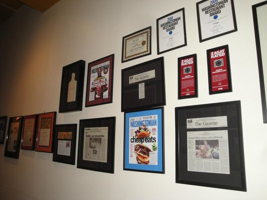 Assaggi Mozzarella Bar: Newspaper Kudos & Awards Lining the Hall to the Restaurant's Bathrooms