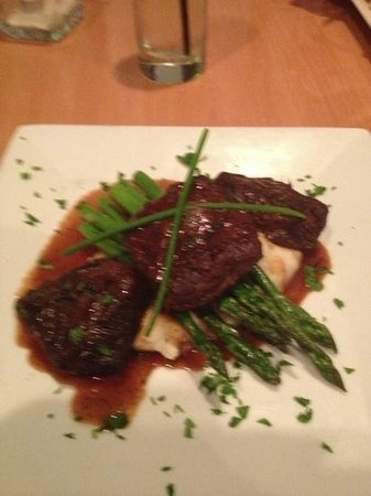 Coquina Beach Surf Club:                   Best short ribs I've ever tasted