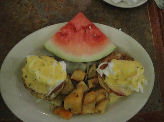 Banana Cafe & Piano Bar: Banana Café Brunch Menu Entree ~ Eggs Benedict with Fried Potatoes & Watermelon