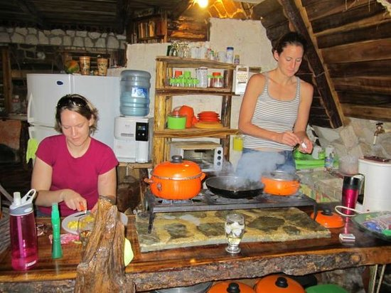 Chalet Tropical Village: Fun - Cooking in the kitchen after a fun time in town. You can eat in town or make food at home.