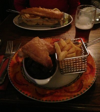 Horse & Farrier Inn: Hearty pie and huge fish behind
