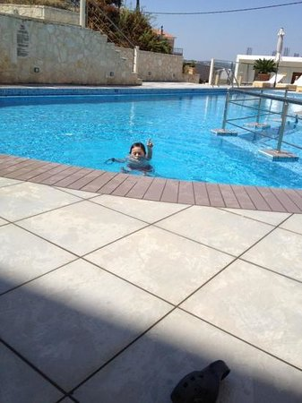 Esthisis Suites:                                     my son at the pool
