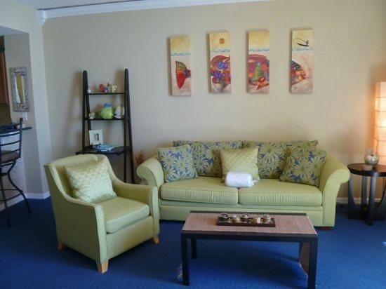 Summerwind Resort:                   Large sitting area with pullout sleeper sofa, cute furniture, but beachy feel