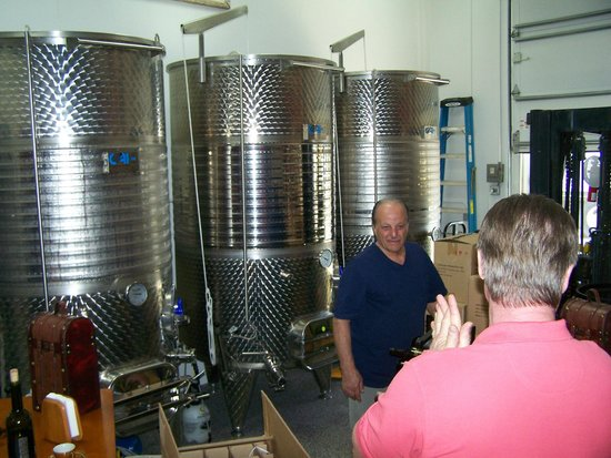 Catania's Winery:                   John showing us his wine.