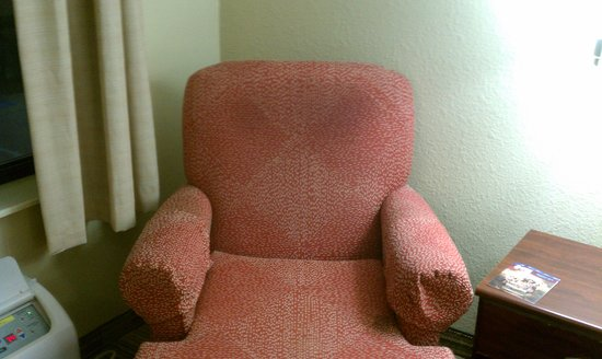 Extended Stay America - Houston - Westchase - Richmond:                   Stains from greasy hair on back of chair