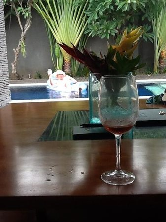 The Wolas Villas & Spa:                   Relaxing in the pool with a drink