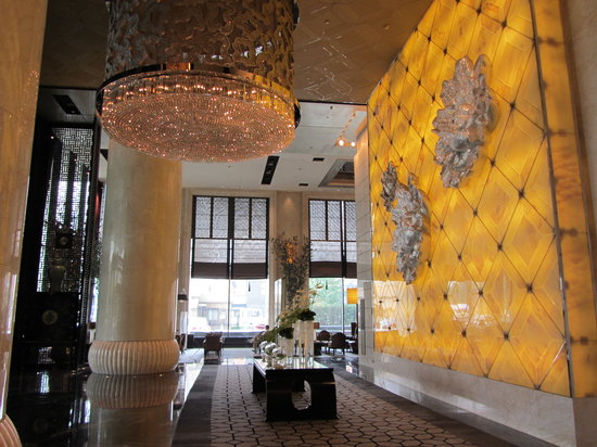 Sofitel Wanda Beijing: Front foyer - Note peony flowers on wall are made of Swarovski crystals
