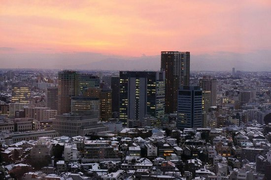 The Strings by InterContinental Tokyo: View from my room on the 27th floor at sunset over snowy Tokyo