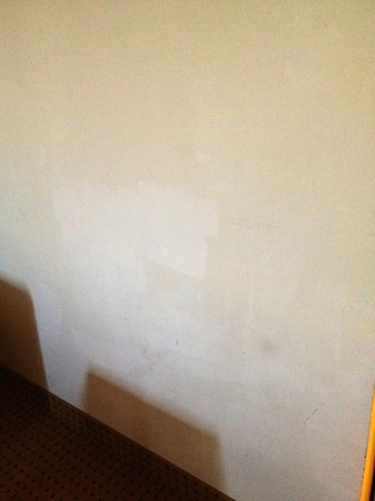 Comfort Suites:                   The walls are poorly painted and touched up