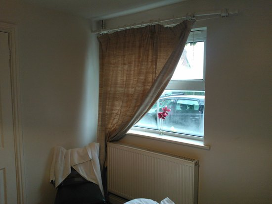 The Blue Boar Inn:                   ground floor room - cars outside, bad curtains