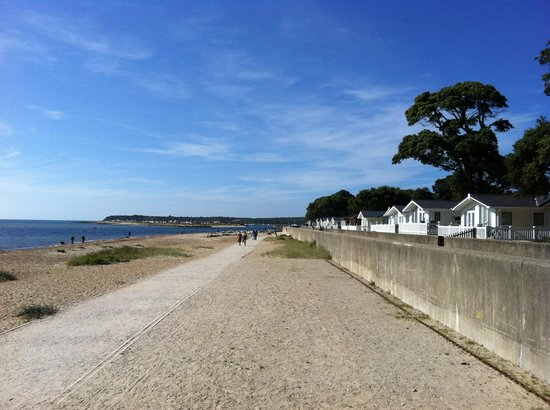 Sandhills Holiday Park - Park Holidays UK:                   Beach and walkway to the quay from the caravan lodge area at Sandhills Holiday
