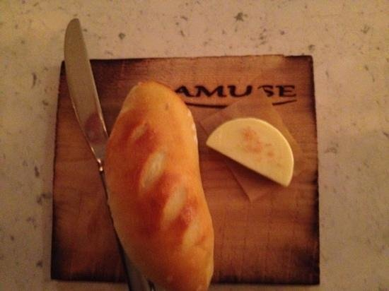 Amuse :                   delicious fresh baked bread. 1st item at the chef's table dinner