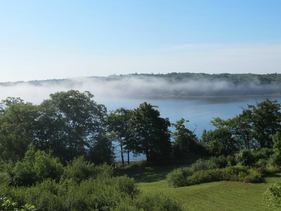 Ledges By the Bay :                   Early morning mist over the water. View from our room.