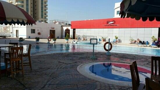Dubai Grand Hotel By Fortune:                   pool area with few nighclubs ...