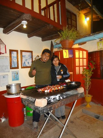 Hostal Magico:                   Edson and Chio hosting a barbeque for the guests!