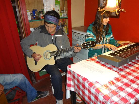 Hostal Magico:                   Guests holding an impromptu concert in the kitchen!