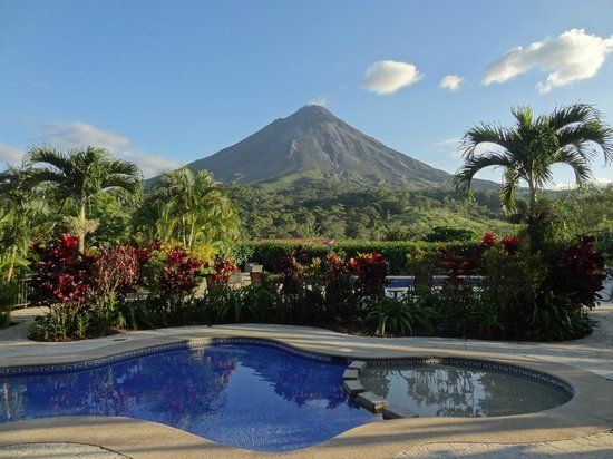 Arenal Kioro Suites & Spa:                   Pool and gardens with Arenal Volcano in background