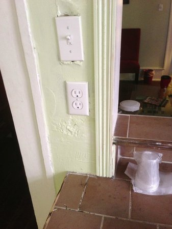 Olde Town Inn:                   Very shoddy work around outlets - UNSAFE