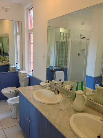 Essenwood House: Double sink vanity, bidet, toilet