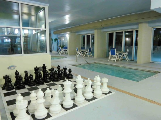 ‪‪Paradise Resort‬: Inddor pool area, chess set with hot Tob‬