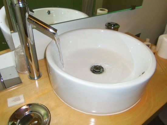 NYLO Dallas Las Colinas:                   Bathroom faucet on full