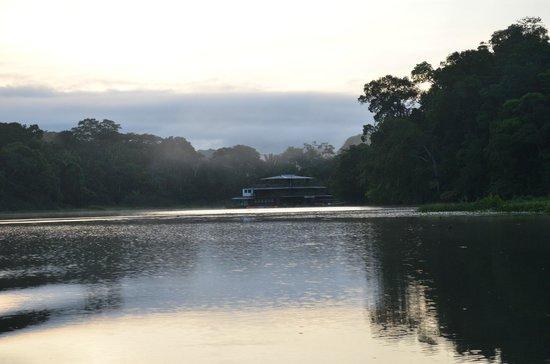 Jungle Land Panama Floating Lodge:                   Houseboat at sunrise