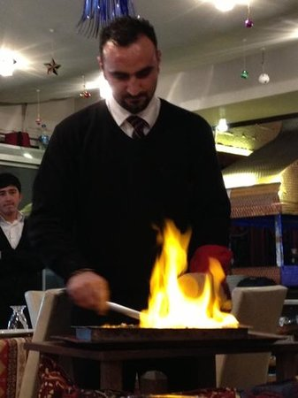Vuslat Grill & Restaurant :                   waiter warming up our delicious food!