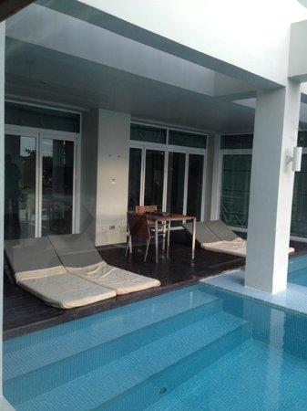 Aleenta Phuket Resort & Spa:                   deck lounge area over pool