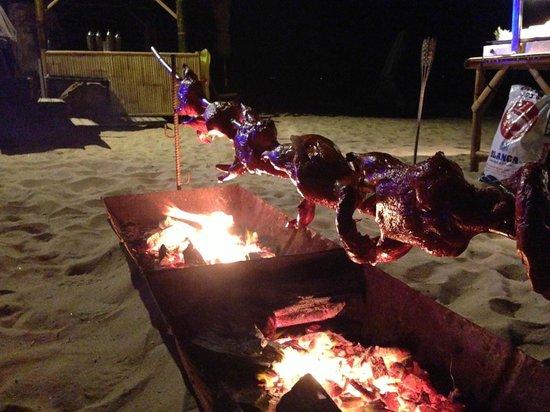 Aleenta Phuket Resort & Spa:                   roast duck over open fire on beach