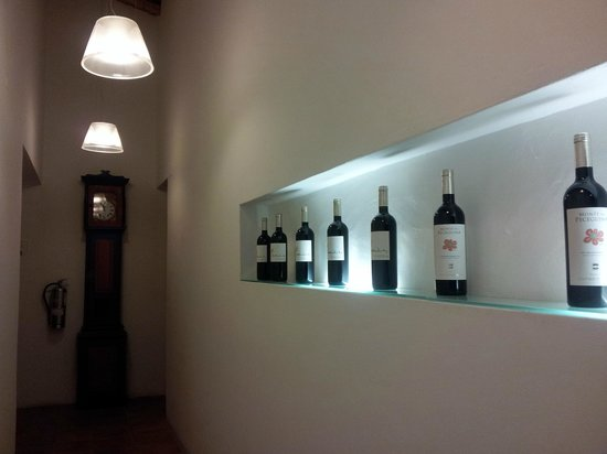 Herdade da Malhadinha Nova:                   Corridor lined with their own wines