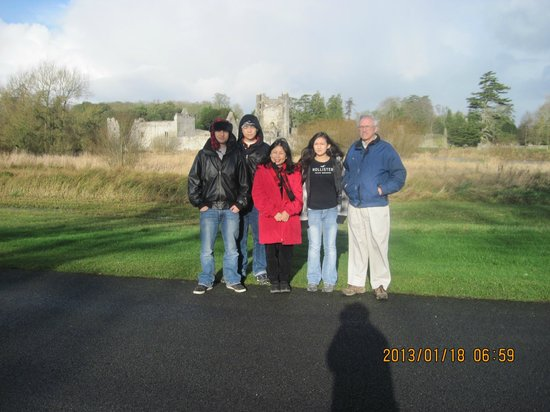 Adare Manor:                   family picture in front of the ruiun