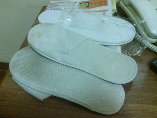 Tagaytay Econo Inn:                   The dirty and already used room slippers that the hotel staffdared to give me!