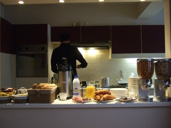 Ambrosia Hotel:                   Vincent cooking our breakfast