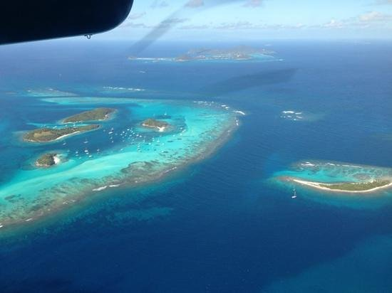 Palm Island Resort & Spa:                   Nearby Tabago Cays, photo taken from plane just after leaving Union Island. Th