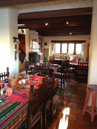 Hacienda del Sol:                   The cozy breakfast area with a view of the grounds and Taos Mountain.        