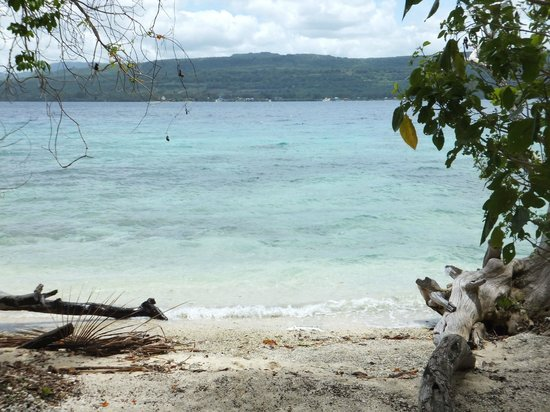 Tranquillity Island Resort & Dive Base:                   Private beach outside fare.