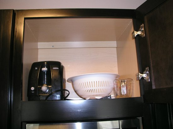 HYATT house Raleigh Durham Airport: toaster and strainer and measuring cup in cabinet