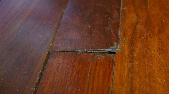 Villa Maly:                   Warped floor board in front of door