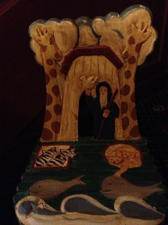 Hotel Winneshiek:                   one of a set of hand-painted chairs in a children's reading nook off the lobby