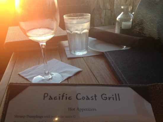 Pacific Coast Grill:                   choosing from the many options having a glass of wine watching the sunset