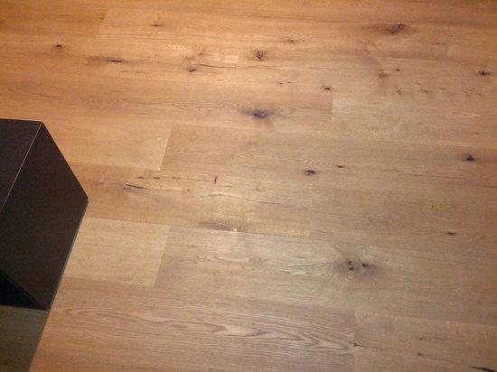 Hotel Raetia:                   Hardwood flooring in bedroom