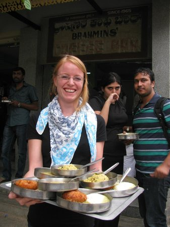Brahmin's Coffee Bar: A vegetarian Swiss holds up her tray of thindi - vada, idly, kesri bhath