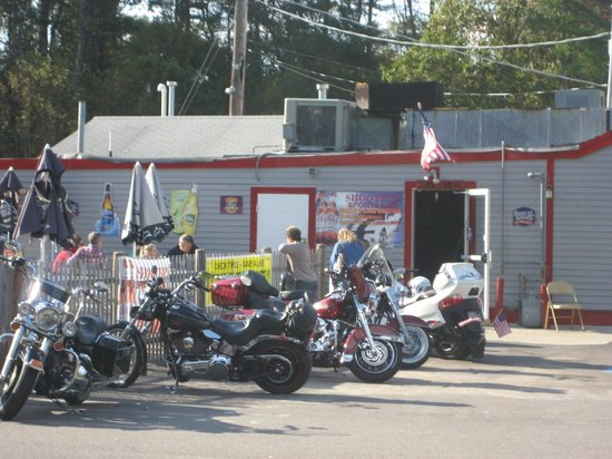 Shooters: Motorcycles Parked Outside Near Side Entrance