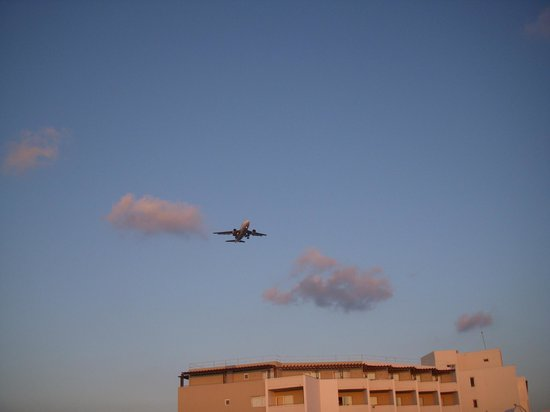 Pylea Beach Hotel:                   View from the pool, landing plane