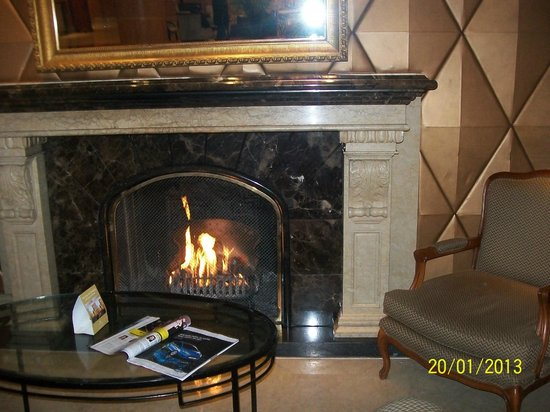Millennium Gloucester Hotel London Kensington: Oh, the weather outside is frightful,But the fire is so delightful,