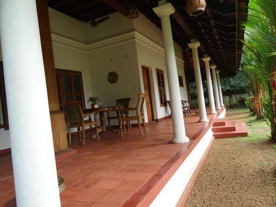 Kovilakam Lakeside Villa:                   red verandah runs around the house